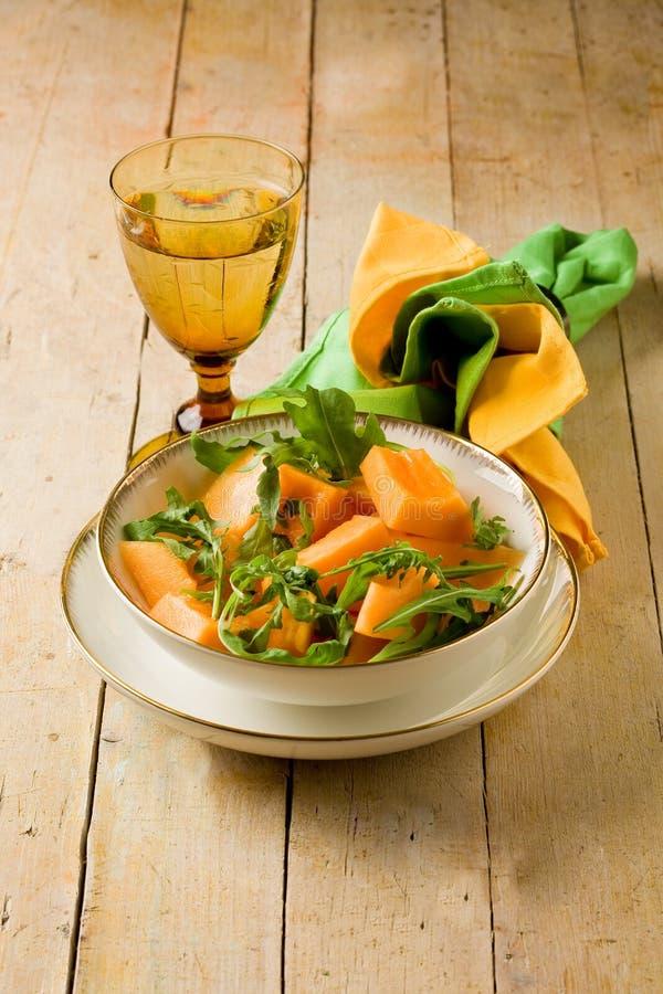 σαλάτα πεπονιών arugula στοκ φωτογραφία