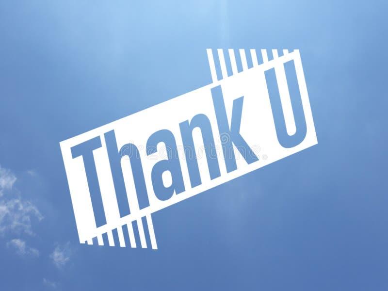 Σας ευχαριστήστε μήνυμα στο άσπρο χρώμα πέρα από ένα υπόβαθρο μπλε ουρανού στοκ φωτογραφίες με δικαίωμα ελεύθερης χρήσης