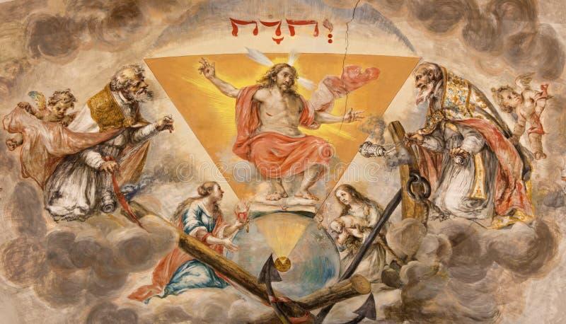 Σεβίλη - ο αναστημένος νωπογραφία Χριστός στο ανώτατο όριο του πρεσβυτερίου στην εκκλησία Hospital de Los Venerables Sacerdotes στοκ εικόνα