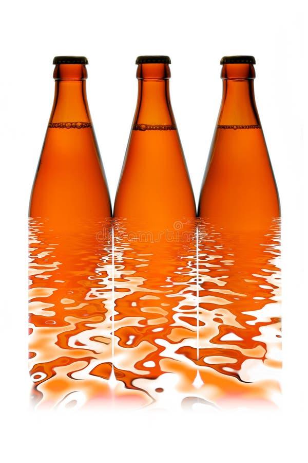 σειρά τρία μπουκαλιών μπύρα& στοκ φωτογραφίες