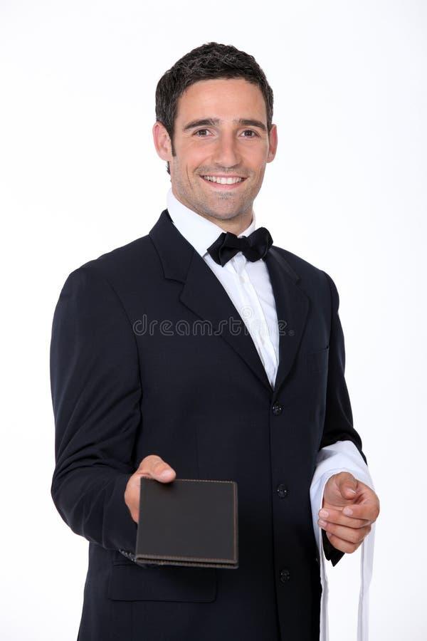 Σερβιτόρος με επιλογές στοκ φωτογραφίες