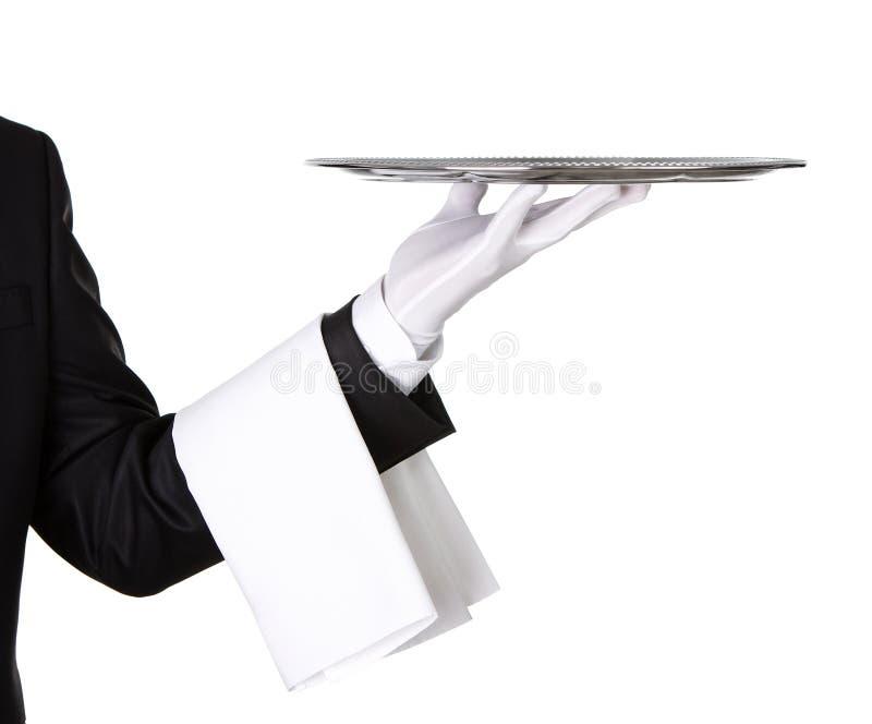 Σερβιτόρος με τον κενό ασημένιο δίσκο στοκ φωτογραφίες