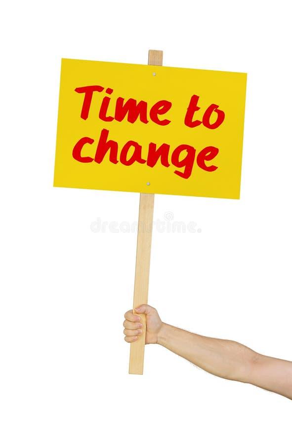 Σημάδι εκμετάλλευσης προσώπων που λέει το χρόνο να αλλάξει στοκ φωτογραφία