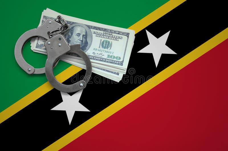 Σημαία Σαιντ Κιτς και Νέβις με τις χειροπέδες και μια δέσμη των δολαρίων Η έννοια της παράβασης του νόμου και των εγκλημάτων κλεφ στοκ εικόνα