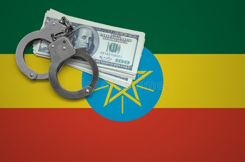Σημαία της Αιθιοπίας με τις χειροπέδες και μια δέσμη των δολαρίων Η έννοια της παράβασης του νόμου και των εγκλημάτων κλεφτών στοκ εικόνες με δικαίωμα ελεύθερης χρήσης