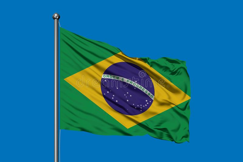 Σημαία της Βραζιλίας που κυματίζει στον αέρα ενάντια στο βαθύ μπλε ουρανό Βραζιλιάνα σημαία ελεύθερη απεικόνιση δικαιώματος
