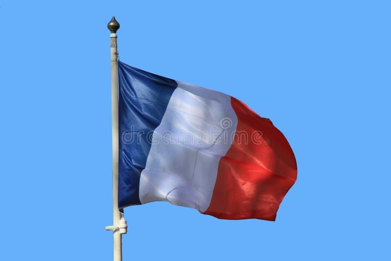 Σημαία της Γαλλίας που κυματίζει στον αέρα στο υπόβαθρο μπλε ουρανού στοκ εικόνα