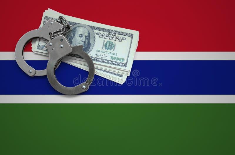 Σημαία της Γκάμπιας με τις χειροπέδες και μια δέσμη των δολαρίων Η έννοια της παράβασης του νόμου και των εγκλημάτων κλεφτών στοκ εικόνες με δικαίωμα ελεύθερης χρήσης