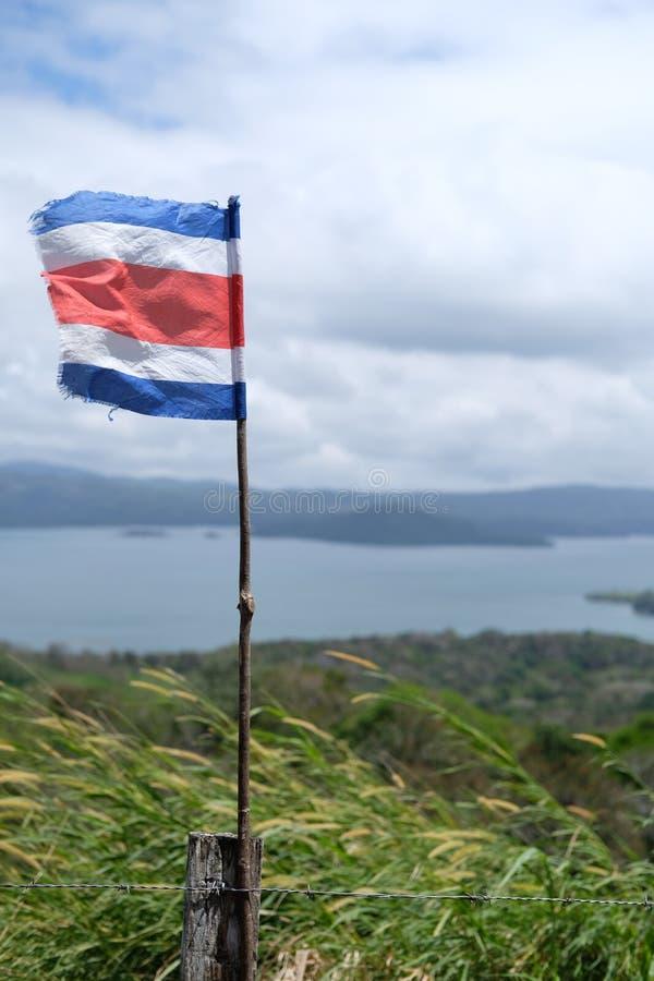 Σημαία της Κόστα Ρίκα από τη λίμνη Arenal στοκ φωτογραφίες