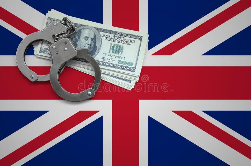 Σημαία της Μεγάλης Βρετανίας με τις χειροπέδες και μια δέσμη των δολαρίων Η έννοια της παράβασης του νόμου και των εγκλημάτων κλε στοκ εικόνες