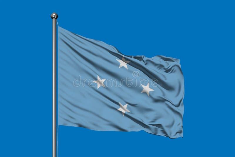 Σημαία της Μικρονησίας που κυματίζει στον αέρα ενάντια στο βαθύ μπλε ουρανό Συνενωμένα σε ομοσπονδία κράτη της σημαίας της Μικρον στοκ εικόνες