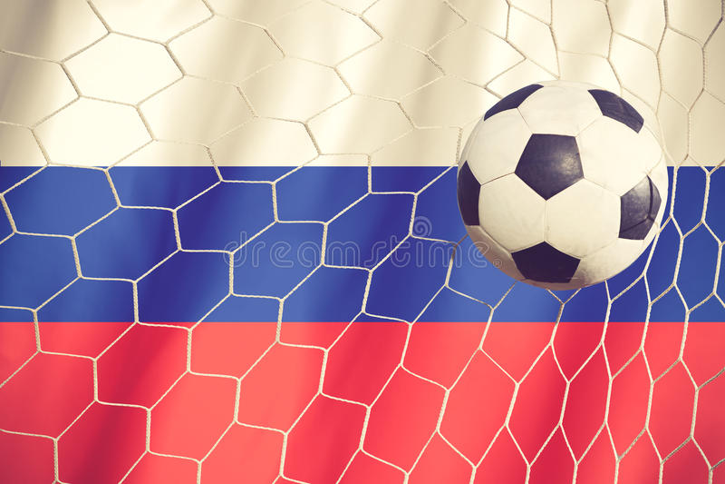 Σημαία της Ρωσίας με τη σφαίρα ποδοσφαίρου πρωταθλήματος στοκ φωτογραφίες