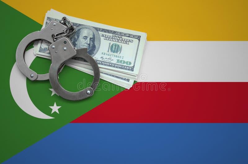 Σημαία των Κομορών με τις χειροπέδες και μια δέσμη των δολαρίων Η έννοια της παράβασης του νόμου και των εγκλημάτων κλεφτών στοκ εικόνες