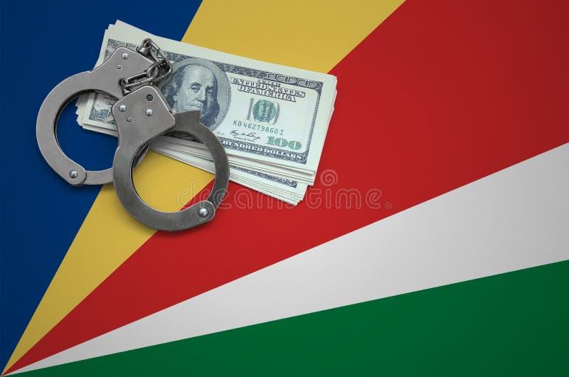 Σημαία των Σεϋχελλών με τις χειροπέδες και μια δέσμη των δολαρίων Η έννοια της παράβασης του νόμου και των εγκλημάτων κλεφτών στοκ εικόνα