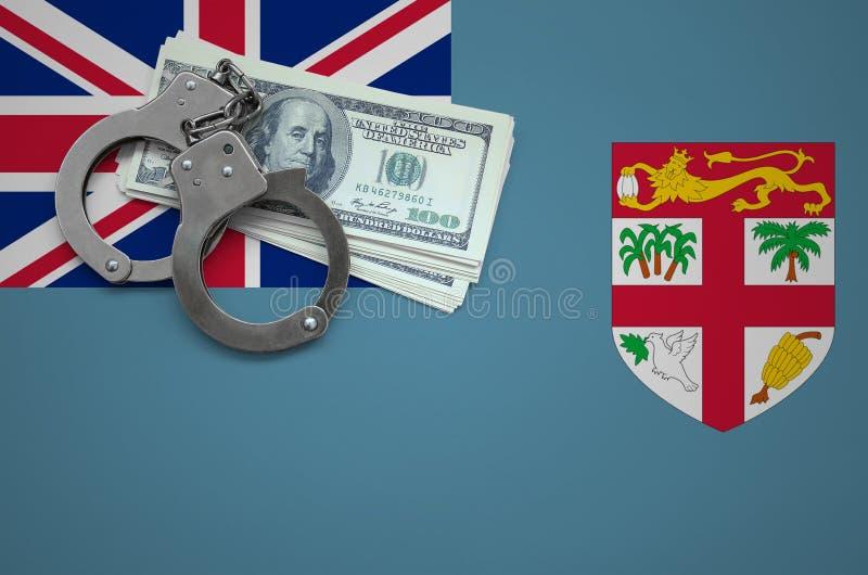 Σημαία των Φίτζι με τις χειροπέδες και μια δέσμη των δολαρίων Η έννοια της παράβασης του νόμου και των εγκλημάτων κλεφτών στοκ εικόνα