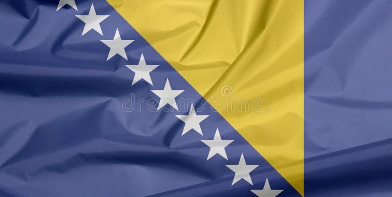 Σημαία υφάσματος Βοσνίας-Ερζεγοβίνης Πτυχή του υποβάθρου σημαιών της Βοσνίας διανυσματική απεικόνιση