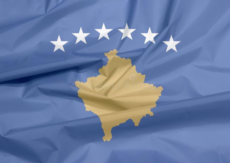 Σημαία υφάσματος Κοσόβου Πτυχή του υποβάθρου σημαιών Κοσόβου απεικόνιση αποθεμάτων
