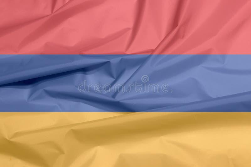 Σημαία υφάσματος της Αρμενίας Πτυχή του αρμενικού υποβάθρου σημαιών απεικόνιση αποθεμάτων