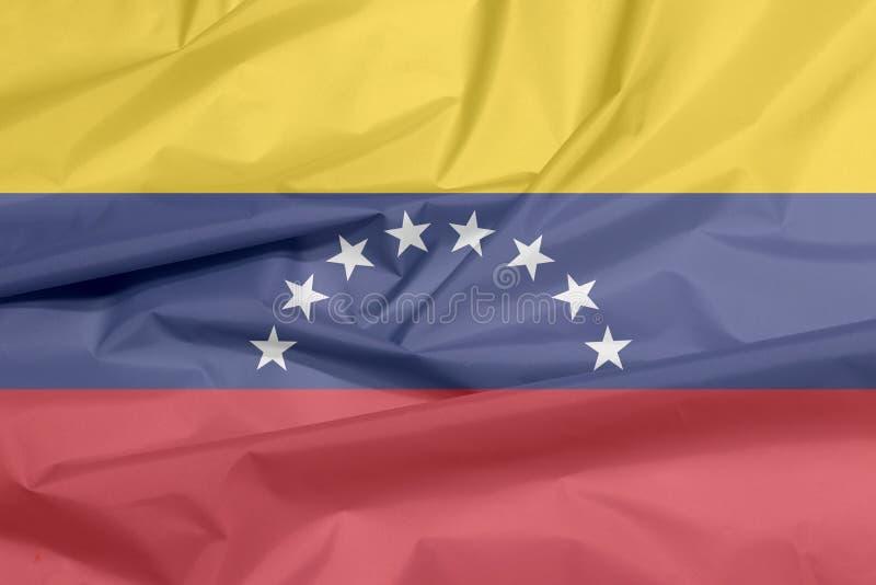 Σημαία υφάσματος της Βενεζουέλας Πτυχή του της Βενεζουέλας υποβάθρου σημαιών διανυσματική απεικόνιση