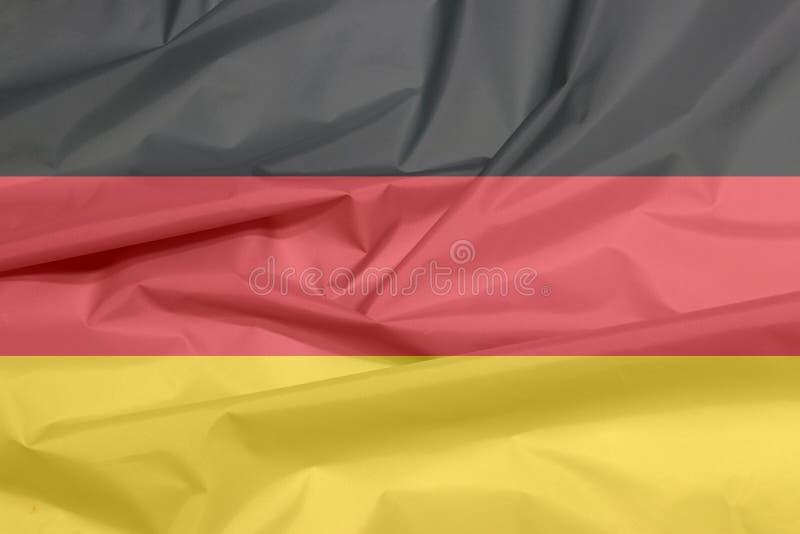 Σημαία υφάσματος της Γερμανίας Πτυχή του γερμανικού υποβάθρου σημαιών απεικόνιση αποθεμάτων