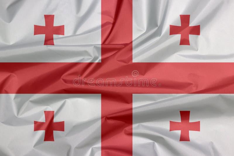 Σημαία υφάσματος της Γεωργίας Πτυχή του της Γεωργίας υποβάθρου σημαιών απεικόνιση αποθεμάτων