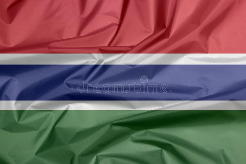 Σημαία υφάσματος της Γκάμπιας Πτυχή του της Γκάμπια υποβάθρου σημαιών απεικόνιση αποθεμάτων