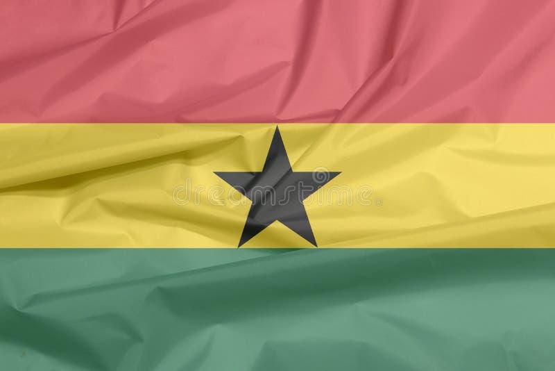 Σημαία υφάσματος της Γκάνας Πτυχή του από τη Γκάνα υποβάθρου σημαιών ελεύθερη απεικόνιση δικαιώματος
