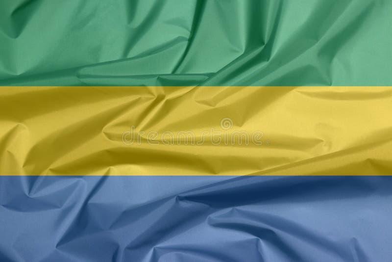 Σημαία υφάσματος της Γκαμπόν Πτυχή του υποβάθρου σημαιών Gabones ελεύθερη απεικόνιση δικαιώματος