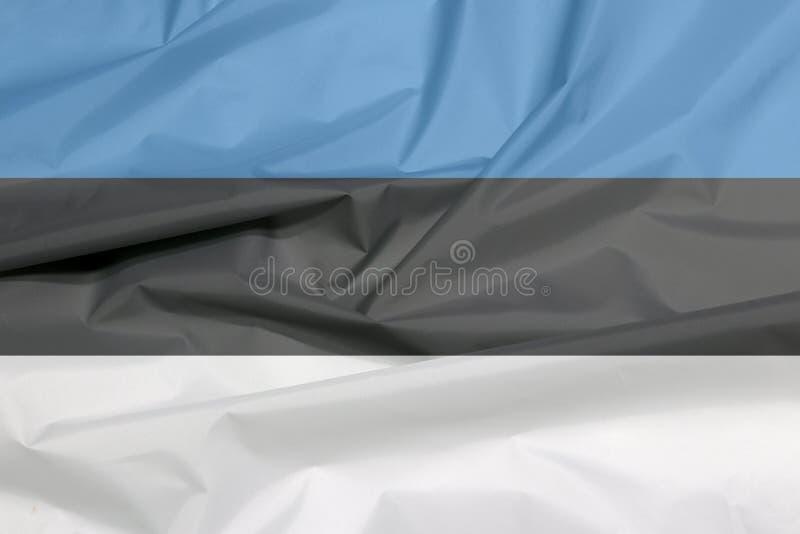 Σημαία υφάσματος της Εσθονίας Πτυχή του εσθονικού υποβάθρου σημαιών απεικόνιση αποθεμάτων