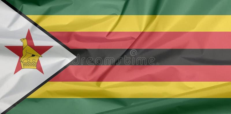 Σημαία υφάσματος της Ζιμπάμπουε Πτυχή του της Ζιμπάμπουε υποβάθρου σημαιών απεικόνιση αποθεμάτων