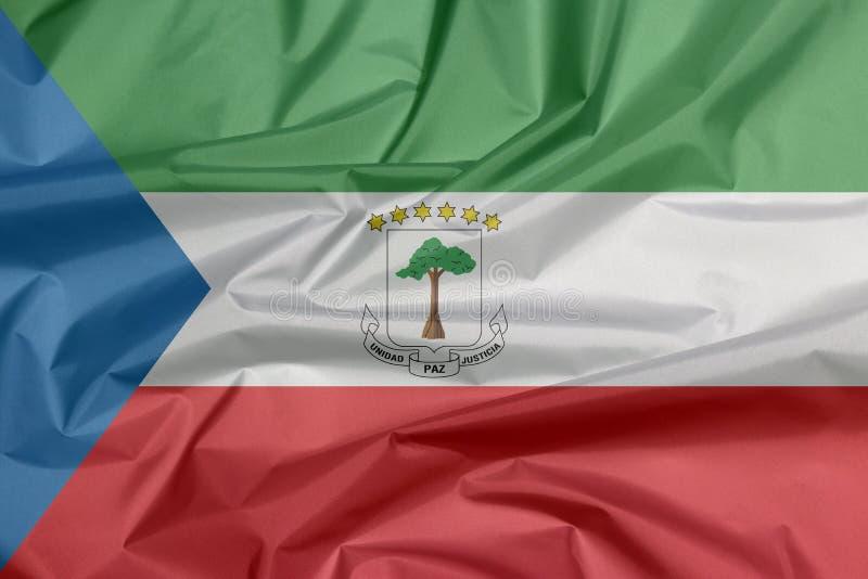 Σημαία υφάσματος της Ισημερινής Γουινέας Πτυχή του υποβάθρου σημαιών της Ισημερινής Γουινέας απεικόνιση αποθεμάτων