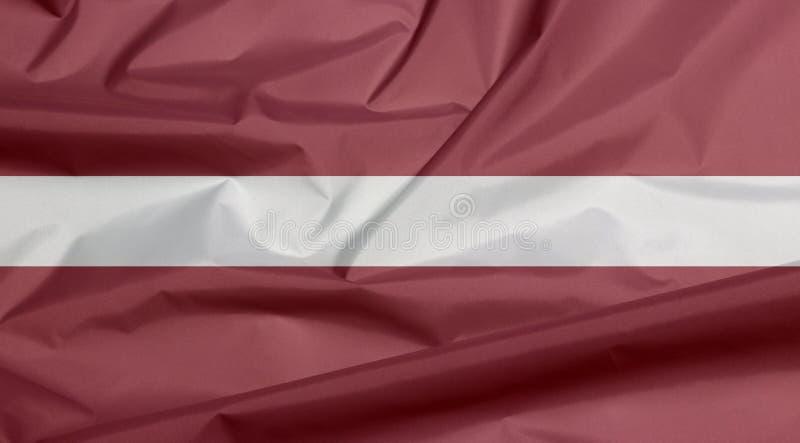 Σημαία υφάσματος της Λετονίας Πτυχή του λετονικού υποβάθρου σημαιών ελεύθερη απεικόνιση δικαιώματος