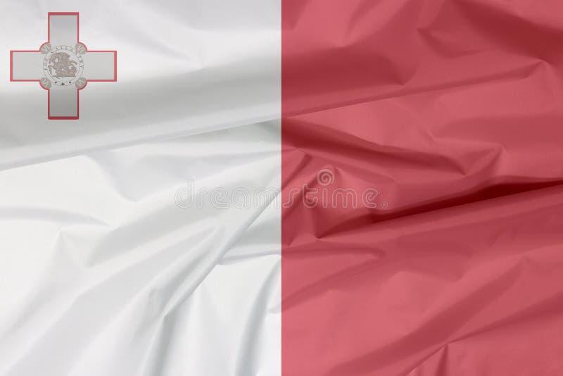 Σημαία υφάσματος της Μάλτας Πτυχή του της Μάλτα υποβάθρου σημαιών απεικόνιση αποθεμάτων