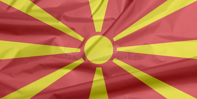 Σημαία υφάσματος της Μακεδονίας Πτυχή του μακεδονικού υποβάθρου σημαιών ελεύθερη απεικόνιση δικαιώματος