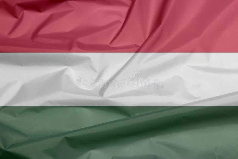 Σημαία υφάσματος της Ουγγαρίας Πτυχή του ουγγρικού υποβάθρου σημαιών διανυσματική απεικόνιση