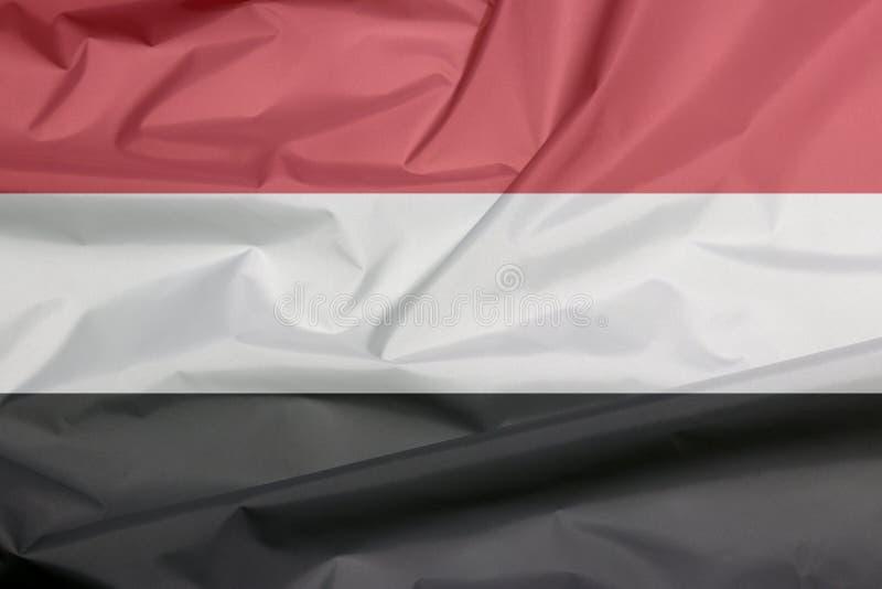 Σημαία υφάσματος της Υεμένης Πτυχή του υποβάθρου σημαιών Γιεμενιτών απεικόνιση αποθεμάτων