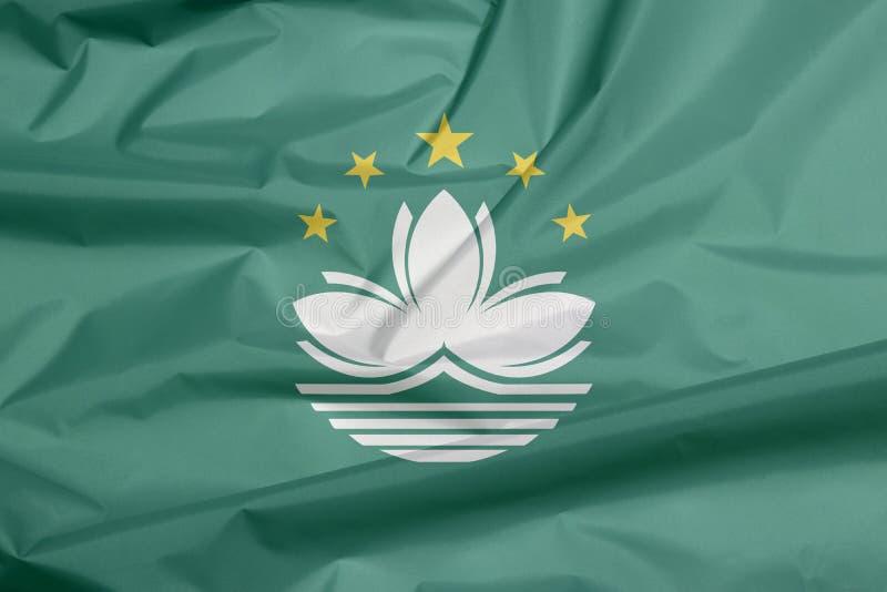 Σημαία υφάσματος του Μακάο Πτυχή του υποβάθρου σημαιών του Μακάο διανυσματική απεικόνιση