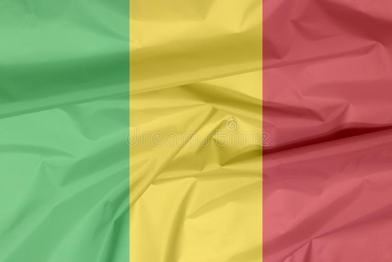 Σημαία υφάσματος του Μαλί Πτυχή του του Μάλι υποβάθρου σημαιών ελεύθερη απεικόνιση δικαιώματος