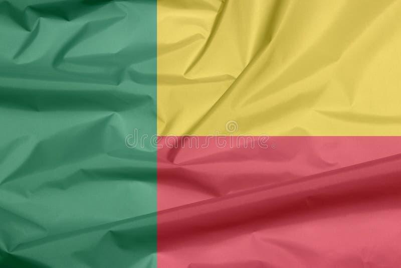 Σημαία υφάσματος του Μπενίν Πτυχή του του Μπενίν υποβάθρου σημαιών διανυσματική απεικόνιση