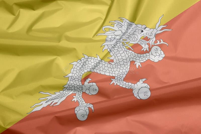Σημαία υφάσματος του Μπουτάν Πτυχή του Bhutanese υποβάθρου σημαιών ελεύθερη απεικόνιση δικαιώματος