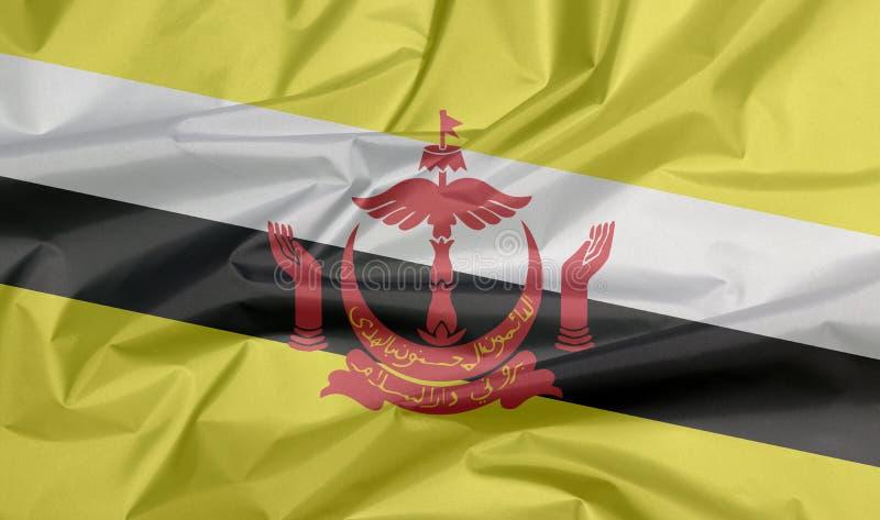 Σημαία υφάσματος του Μπρουνέι Darussalam Πτυχή του υποβάθρου σημαιών του Μπρουνέι στοκ εικόνα με δικαίωμα ελεύθερης χρήσης
