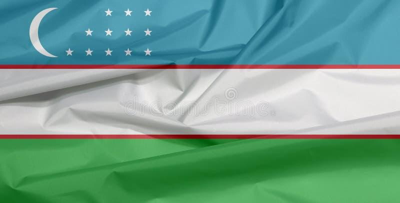 Σημαία υφάσματος του Ουζμπεκιστάν Πτυχή του του Ουζμπεκιστάν υποβάθρου σημαιών απεικόνιση αποθεμάτων