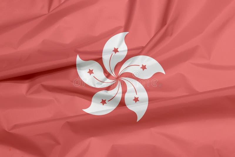 Σημαία υφάσματος του Χογκ Κογκ Πτυχή του υποβάθρου σημαιών του Χογκ Κογκ ελεύθερη απεικόνιση δικαιώματος