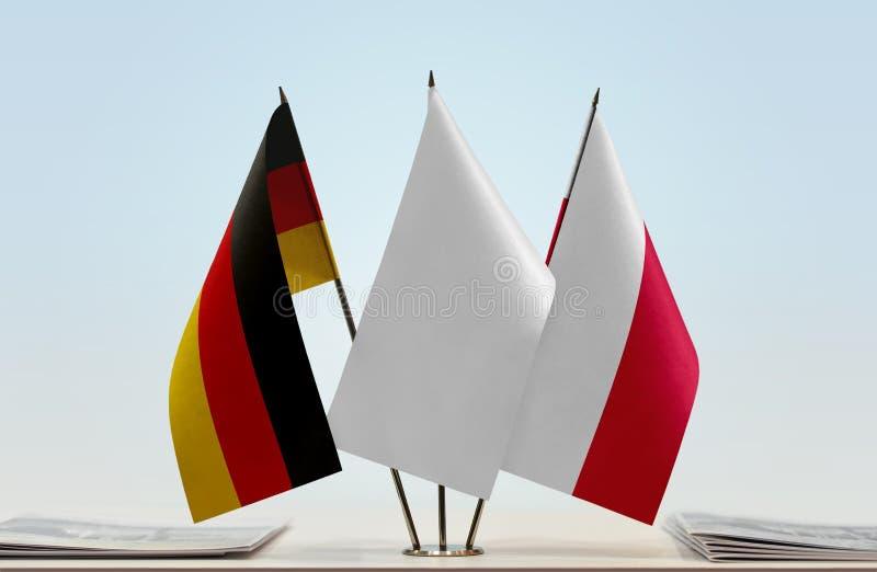 Σημαίες της Γερμανίας και της Πολωνίας στοκ φωτογραφία