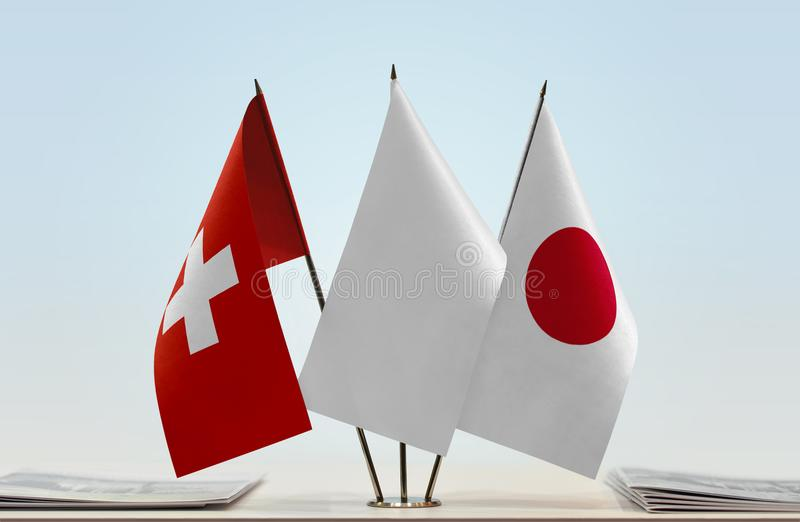 Σημαίες της Ελβετίας και της Ιαπωνίας στοκ εικόνες