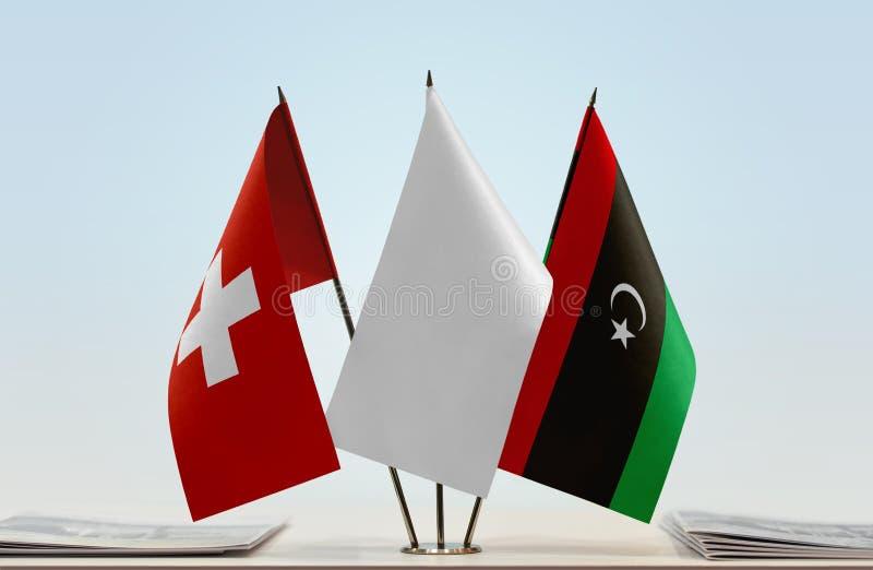 Σημαίες της Ελβετίας και της Λιβύης στοκ εικόνα με δικαίωμα ελεύθερης χρήσης