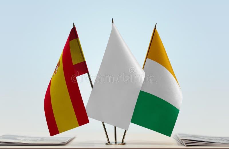 Σημαίες της Ισπανίας και της Ακτής του Ελεφαντοστού στοκ φωτογραφία με δικαίωμα ελεύθερης χρήσης