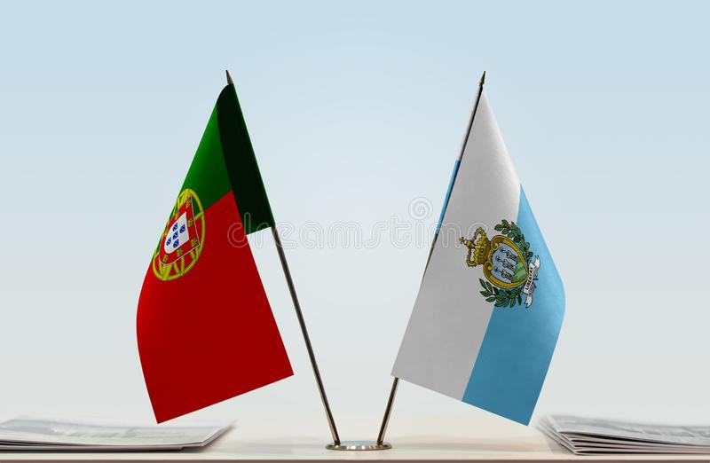Σημαίες της Πορτογαλίας και του Άγιου Μαρίνου στοκ φωτογραφία