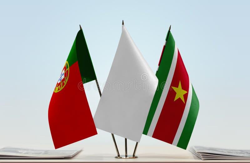 Σημαίες της Πορτογαλίας και του Σουρινάμ στοκ φωτογραφία με δικαίωμα ελεύθερης χρήσης