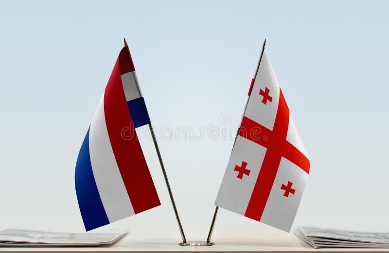 Σημαίες των Κάτω Χωρών και της Γεωργίας στοκ φωτογραφία με δικαίωμα ελεύθερης χρήσης